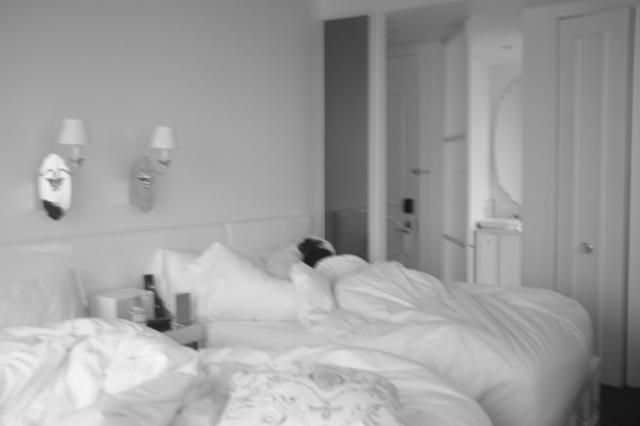 Rebecca asleep in the comfy cloud like bed of the Mondrian Soho.