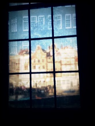 Reflections in the window of the Anne Frank museum. Mobile photography