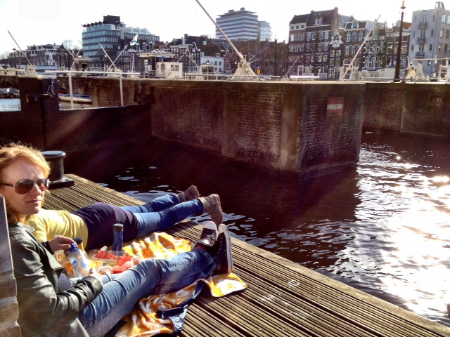 Soaking up the sun on Amstel Gracht is a sure sign of spring in Amsterdam (shot on my iPhone 4s)