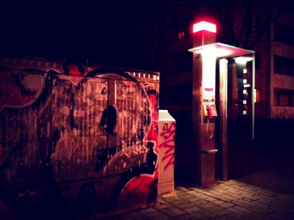 Phone booth street art on Karl Marx Allee. mobile photography