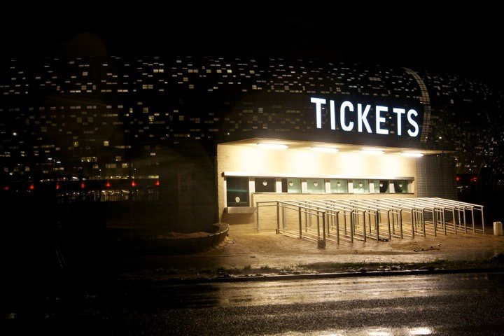 Ticket booth outside Soccer City Stadium. The stadium is stunning in the daytime. It's shaped like a calabash (traditional African cooking pot made of gourd) and the colors beautifully reflect that and the surroundings