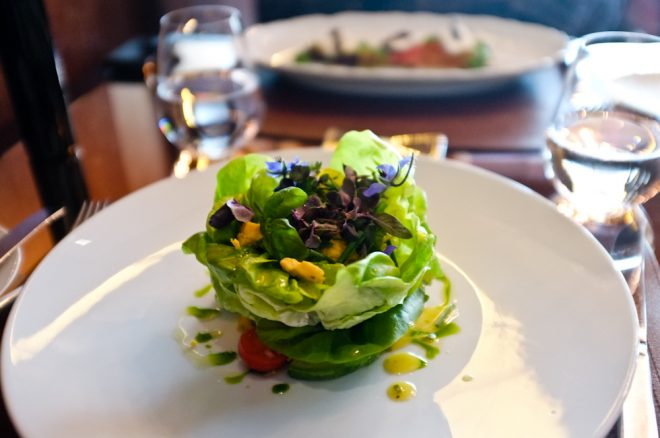 Butter Lettuce Salad, Avocado, Shropshire Blue Cheese, Champagne-Herb Vinaigrette topped with edible flowers at CUT London located inside the exquisite 45 Park Lane