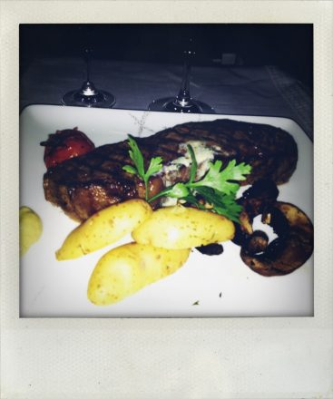 Filet and potatoes that I didn't eat. Cathay Pacific First Class HKG-LAX (mobile photography, shake it app)