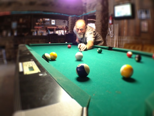 Shooting pool at Pappy and Harriet's