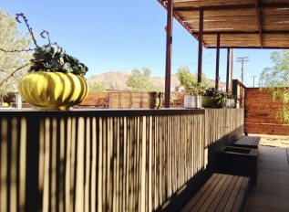 The outdoor patio area of Room 5, the suite, at this funky Joshua Tree motel